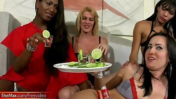 T-girls are drinking vodka in foursome and having fuck orgy